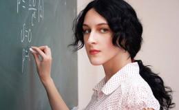 Girl writing formula at the desk